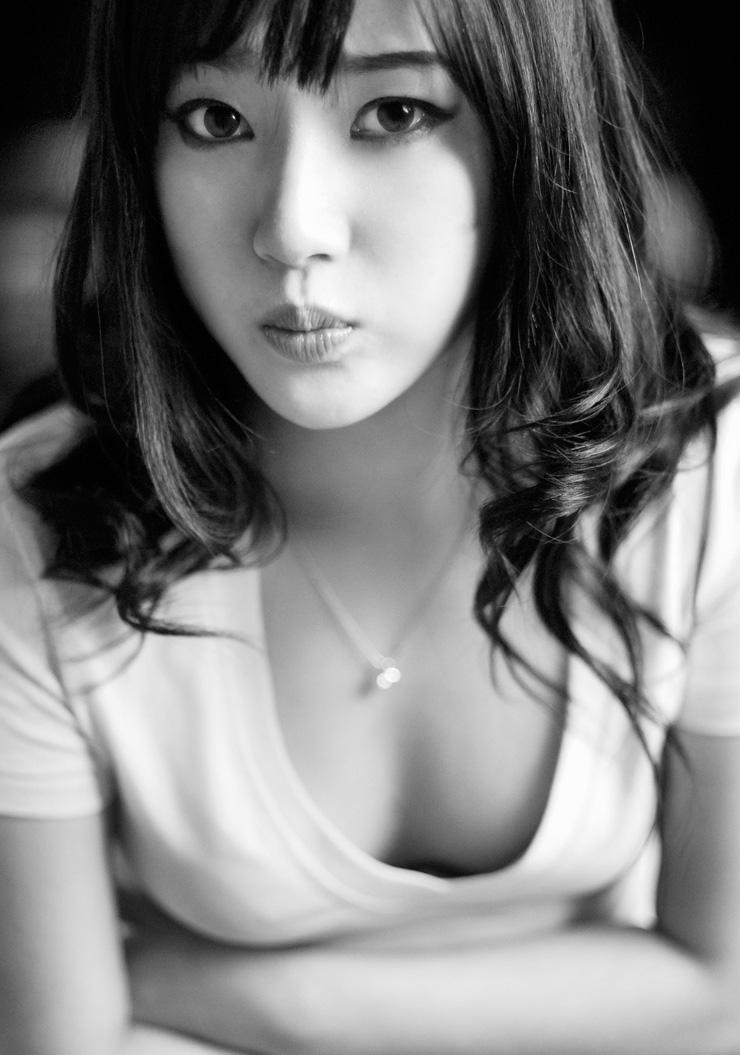 korean woman defined eyes holding breath semi exposed cleavage breasts Tanya Danielle