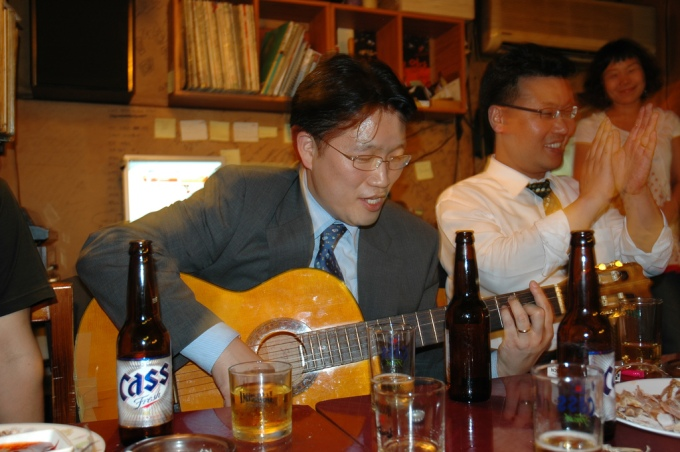 Korean Businessman Playing Guitar